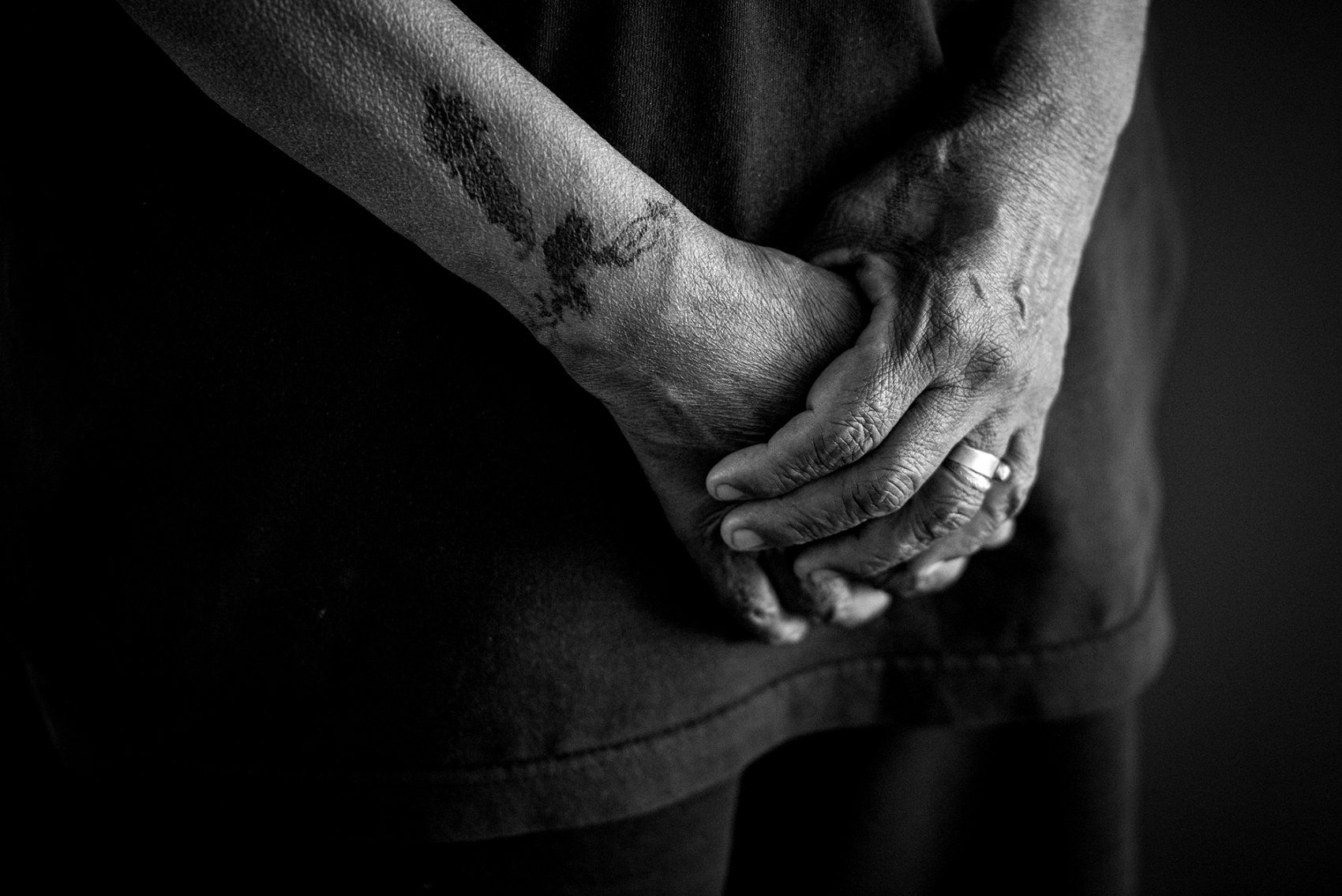 close-up of person's crossed hands