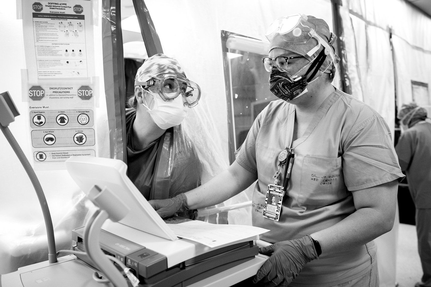 two medical workers talk