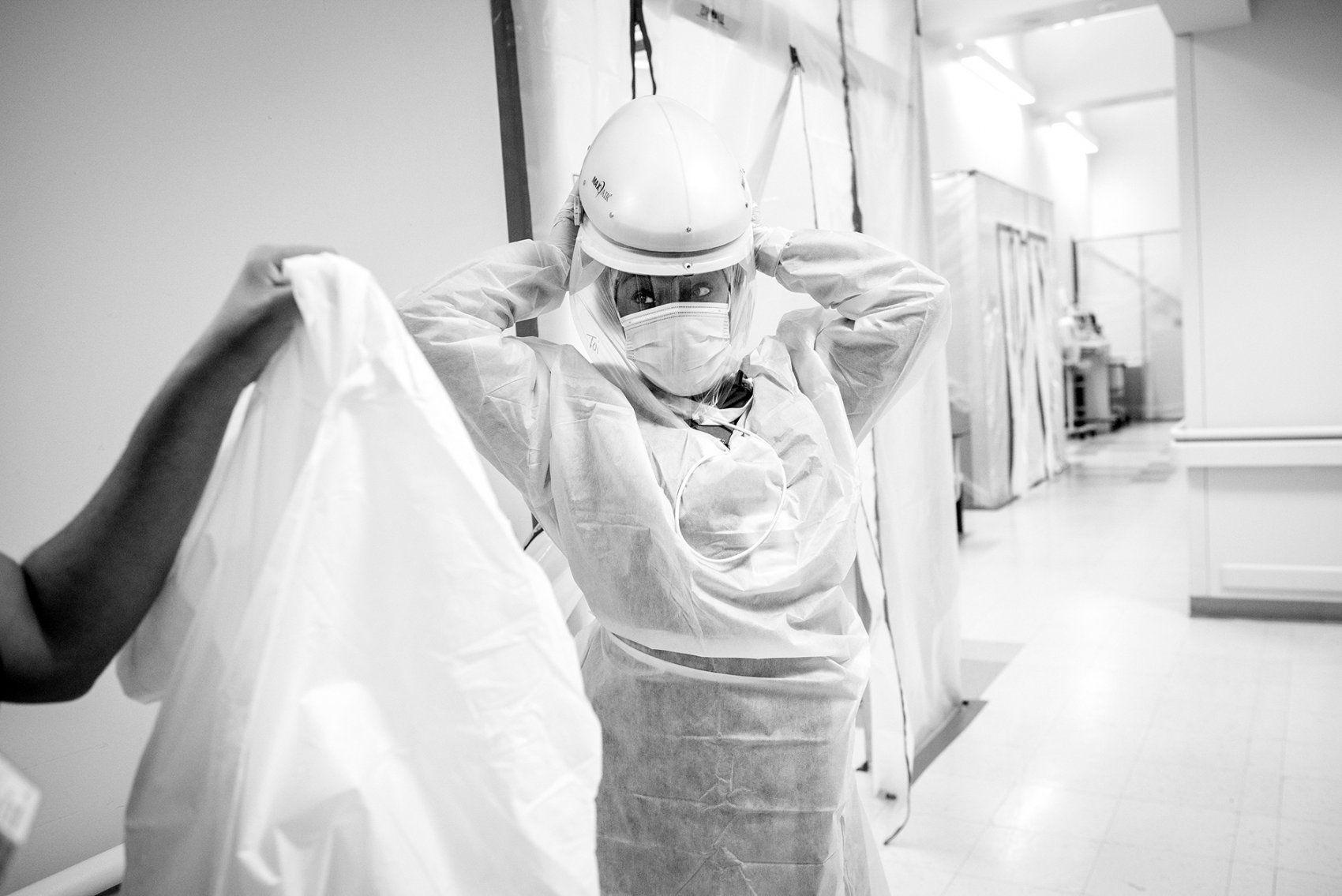 nurse dons protective gear